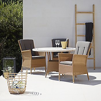 Pictured with the Lansing Table, Lansing Arm Chair and Sweep Rattan Basket (sold separately)