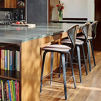 Cherner One Piece Upholstered Stool / in use