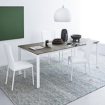 Gray Oak Top/Optic White Frame pictured in use with the Garda Upholstered Chair in White