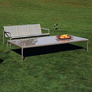 Bronze fabric / Warm Wood frame / Sand trim, in use outdoors